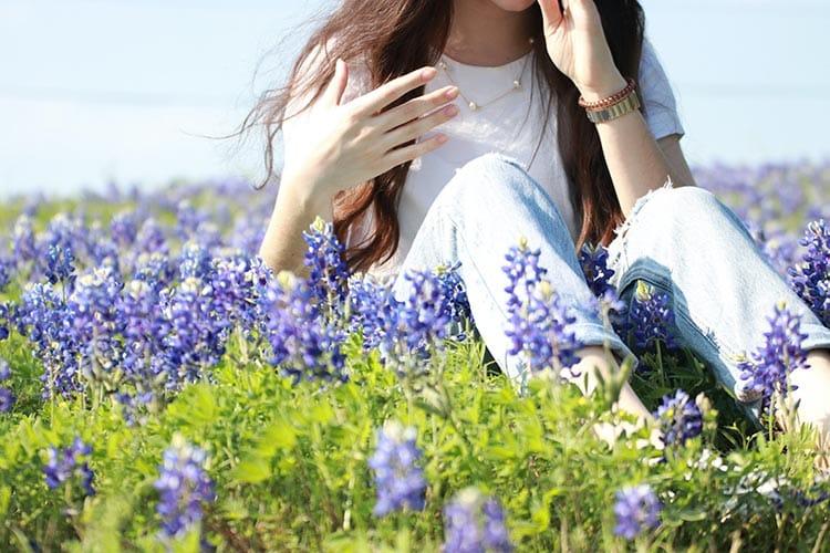 lady sitting in bluebonnets